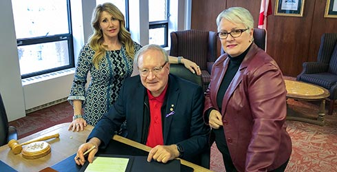 Premier Wade MacLauchlan with Tiny Mundy, Minister of Family and Human Services and Paula Biggar, Minister responsible for the Status of Women to proclaim Family Violence Prevention Week 2019