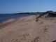 Looking east from the end of the boardwalk at Cavendish Beach